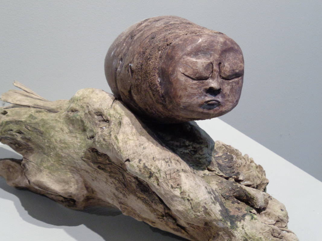 sculpture face and wood base