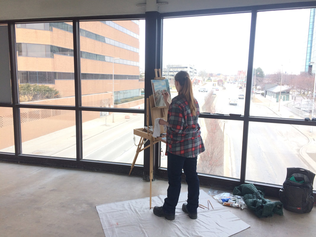 Students plein air painting downtown